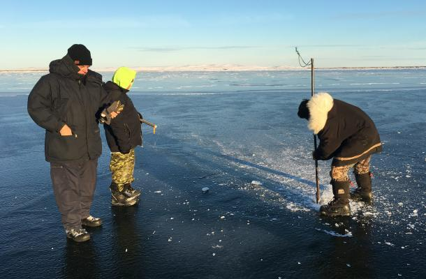 A group prepare to ice fish near Paulatuk.